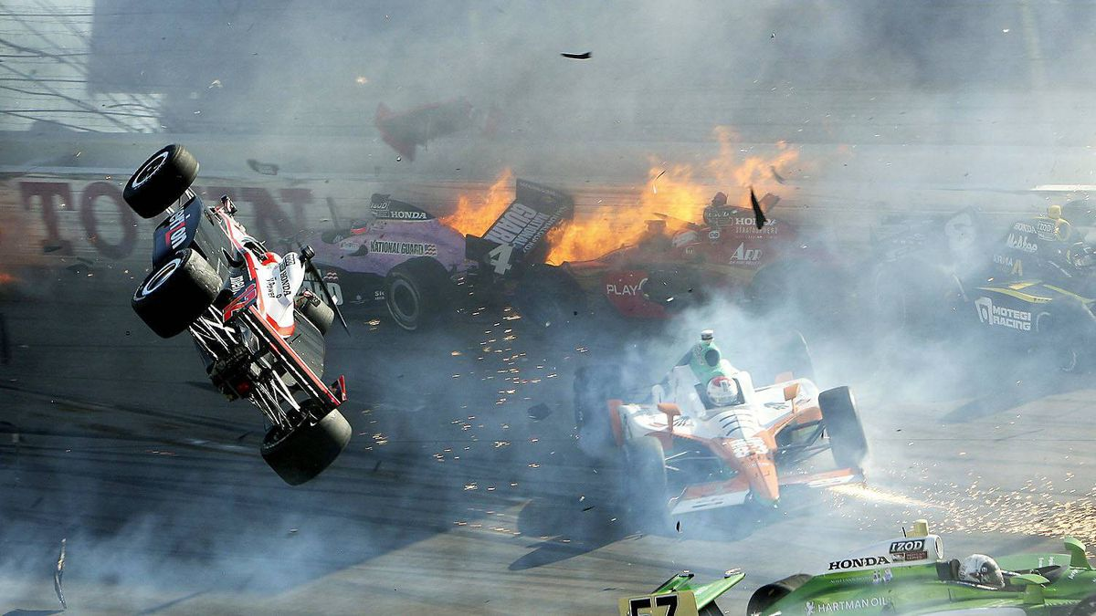 Will Power (L) goes airborne during the IZOD IndyCar World Championship race at the Las Vegas Motor Speedway in Las Vegas, Nevada October 16, 2011.