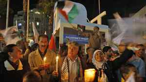 Palestinians hold candles during a rally in the West Bank city of Ramallah, in support of president Mahmoud Abbas's bid for statehood recognition at the United Nations, on Sept. 20, 2011.