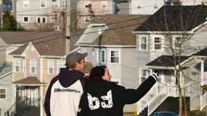 Prospective buyers look at homes in a new sub-division in Lakeside, N.S., on April 15, 2010.