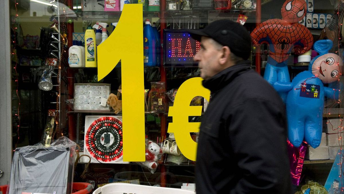 A Kosovo Albanian walks by a lower price shop in Pristina on December 26, 2011.