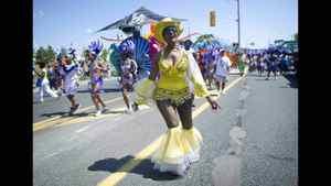 A participant dances in the Caribbean Carnival parade.