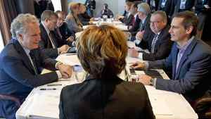 Flanked by Quebec Premier Jean Charest and Ontario's Dalton McGuinty, B.C. Premier Christy Clark chairs a meeting of the Council of the Federation in Victoria on Jan. 16, 2012.