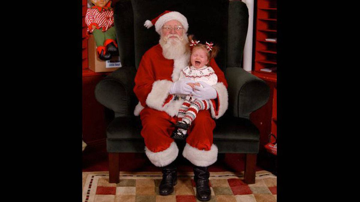 Drew and Lisa Bradstock writes: We received 15 images on a CD from our daughter's Sienna visit with Santa. This was actually the best one and ended up on our Christmas cards.