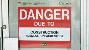 A danger sign is seen outside a construction zone in Ottawa laden with asbestos on June 20, 2011.