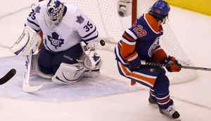 Ryan Jones of the Edmonton Oilers watches the puck go past Toronto Maple Leaf goalie Jean-Sebastien Gigure to score the Oilers fifth goal of the night and defeat the Maple Leafs 5-0 Dec 2, 2010. (Moe Doiron/The Globe and Mail)