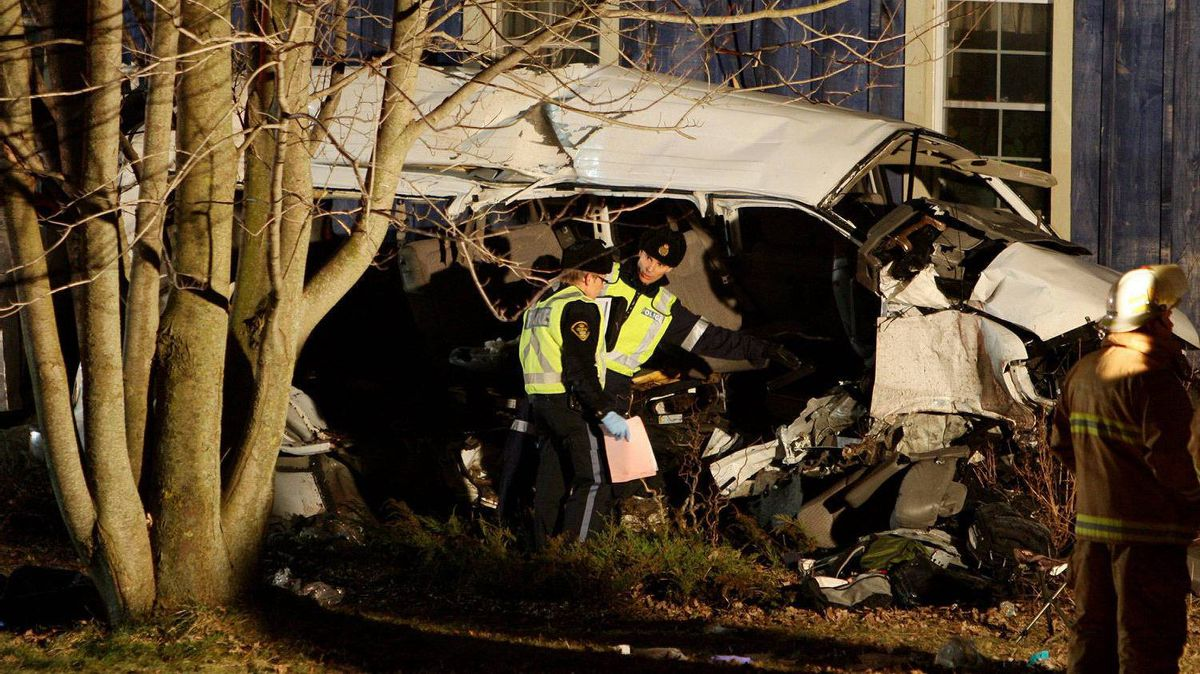 Ontario Provincial Police and emergency crews investigate a multiple fatal motor vehicle accident near Hampstead, Ont., , Feb. 6, 2012. Police say 11 people died in the crash.