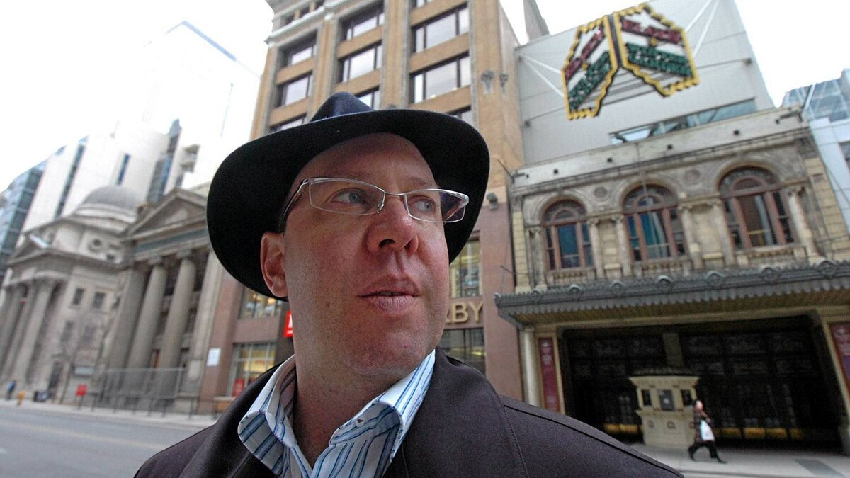 Aubrey Dan, President of Dancap Productions poses for a portrait, with his trademark hat, outside the Elgin Theatre in Toronto,