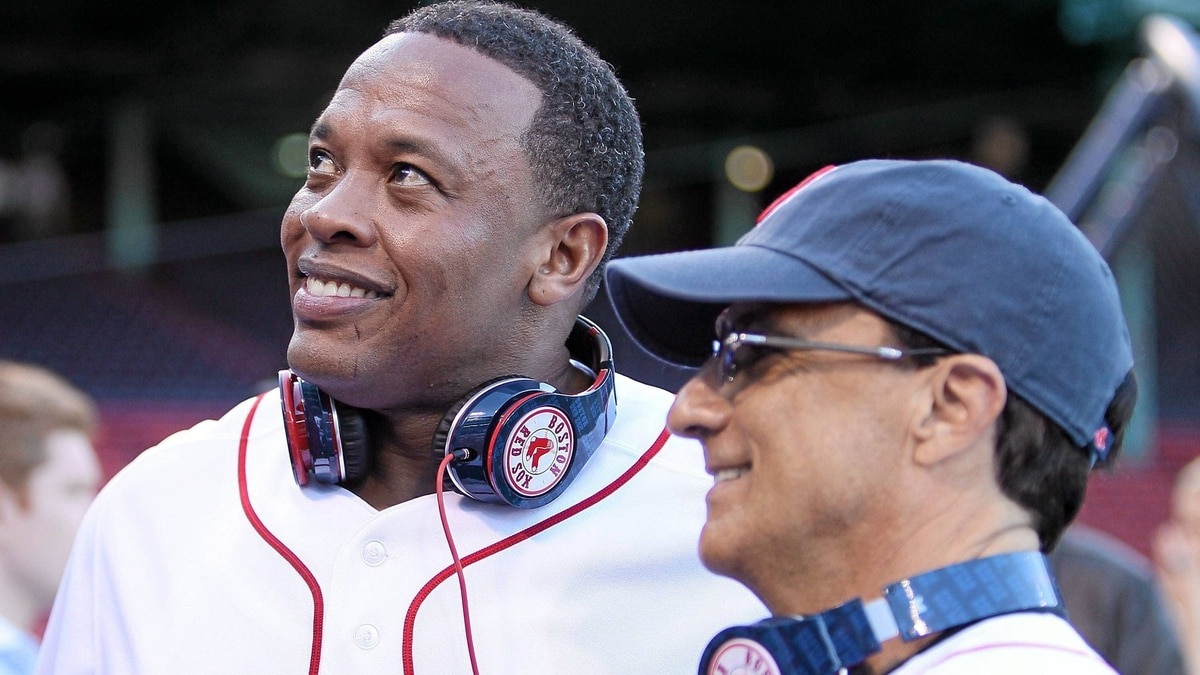 Producer and musician Dr. Dre and Interscope and Geffen Records chairman Jimmy Iovine are on the field before the Boston Red Sox take on the the New York Yankees on April 4, 2010.