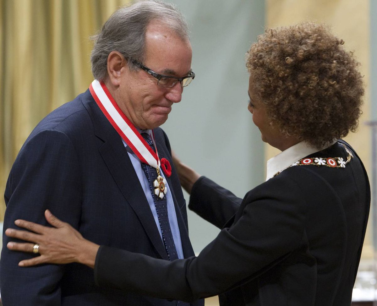 Title: stf Caption: Governor General Michaelle Jean invests Buzz Hargrove as an Officer of the Order of Canada during a ceremony in Ottawa, Thursday Nov. 5, 2009. THE CANADIAN PRESS/ Adrian Wyld