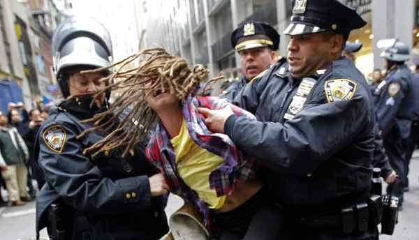 "An Occupy Wall Street demonstrator is arrested by New York City Police during what protest organizers called a ""Day of Action"" in New York November 17, 2011."