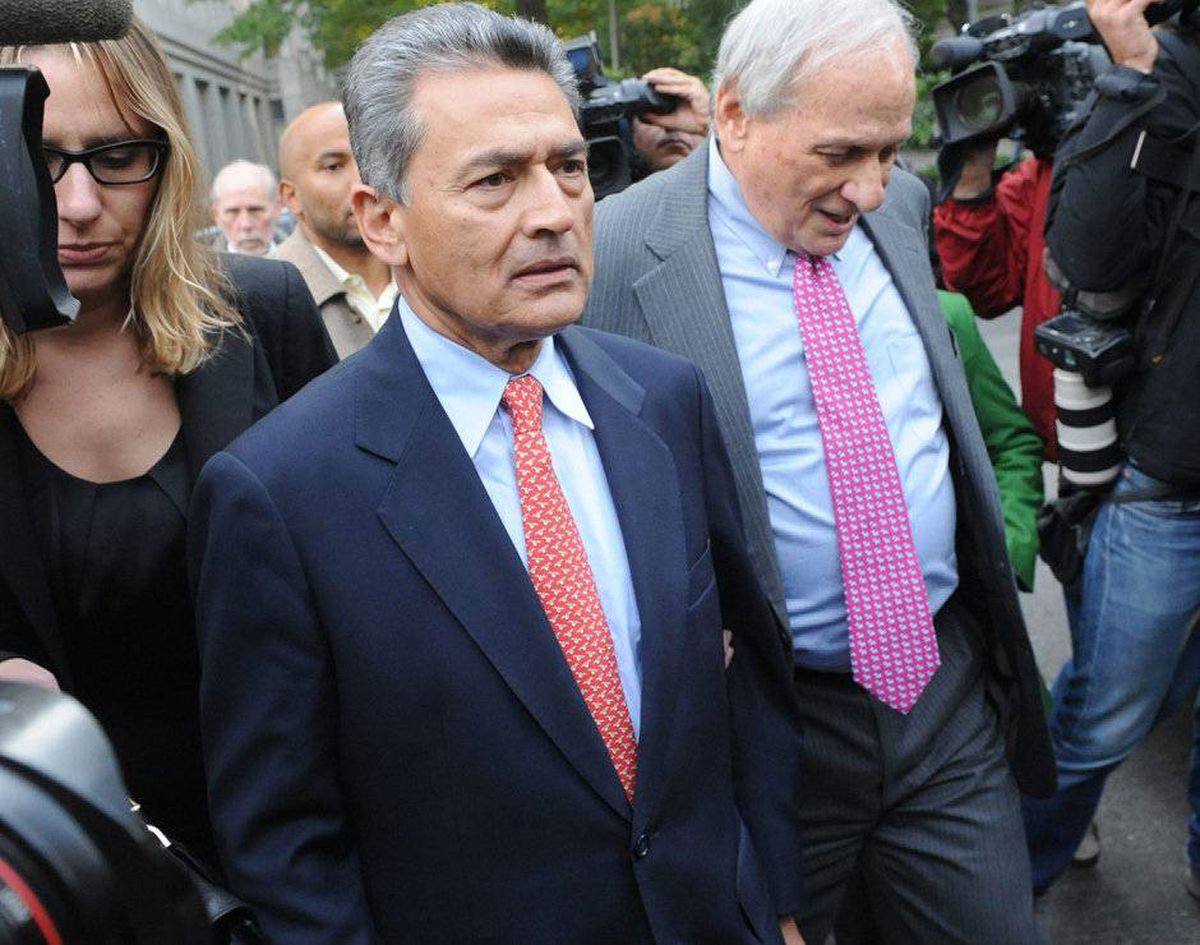 - Former Goldman Sachs board member Rajat Gupta exits Manhattan federal court with his attorney Gary Naftalis, right, following his arraignment, Wednesday, Oct. 26, 2011, in New York.
