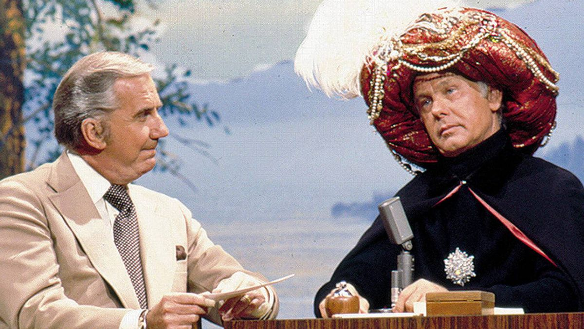Ed McMahon listens while Johnny Carson prognosticates as Carnac the Magnificent on NBC's Tonight Show.