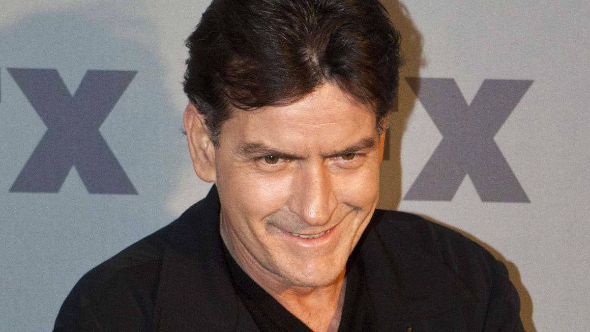 """Charlie Sheen, actor and creator of the FX Networks' show """"Anger Management"""", poses for members of the media at an FX Networks party at Lucky Strike Lanes in New York, March 29, 2012."""