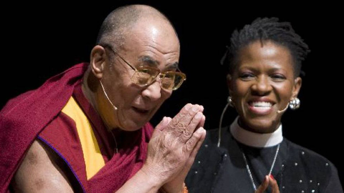 The Dalai Lama, left, greets the crowd prior to a panel discussion with the Reverend Mpho Tutu, right, in Vancouver Sunday. The Dalai Lama is visiting Vancouver to take part in the World Peace Summit. THE CANADIAN PRESS/Jonathan Hayward