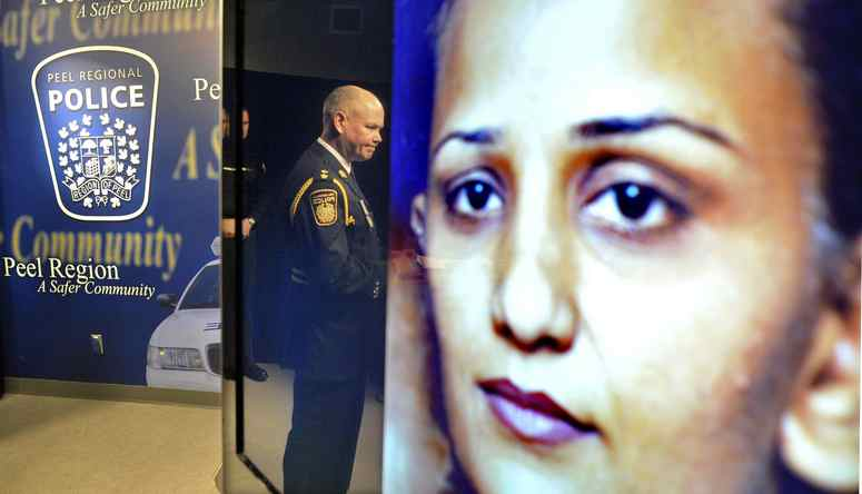 Peel Police Inspector George Koekkoek is reflected in a TV monitor while announcing that the remains of Poonam LITT, who had gone missing in 2009, were discovered in Caledon, during a news conference in Brampton, April 12, 2012.
