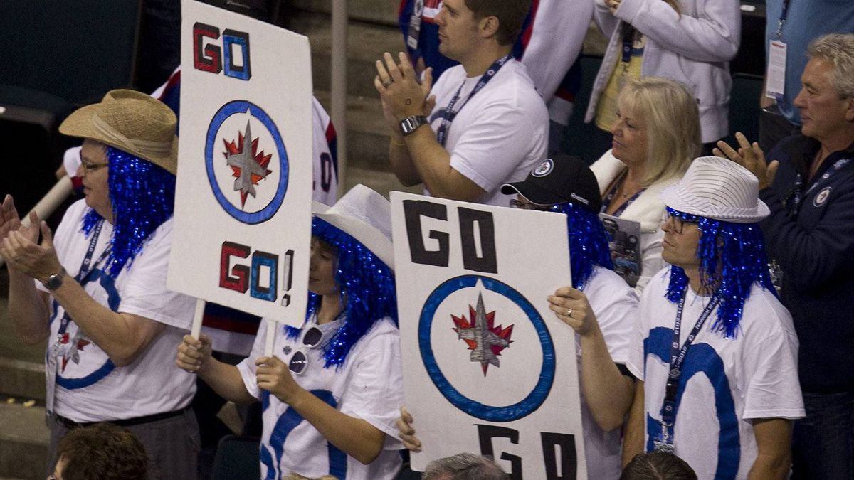 Winnipeg Jets fans give a standing ovation to their team despite a 5-1 loss to the Montreal Canadiens during their inaugural NHL game at the MTS Centre in Winnipeg, Sunday, Oct. 9, 2011. THE CANADIAN PRESS/Jonathan Hayward