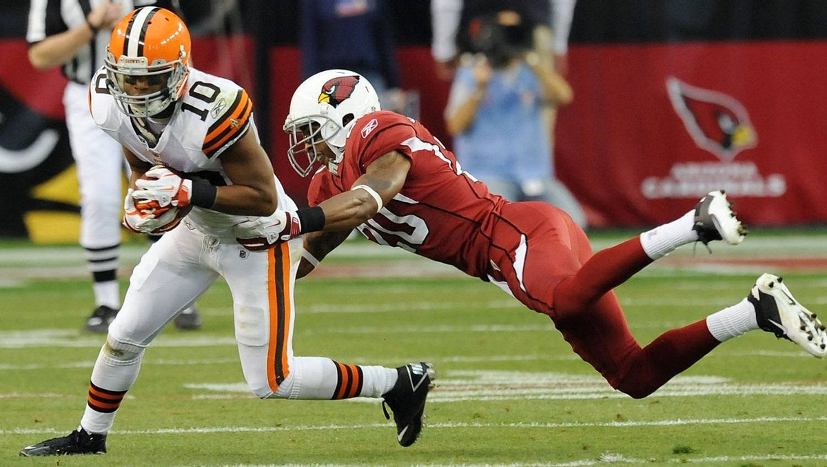 Jordan Norwood #10 of the Cleveland Browns tries to break a tackle by A.J. Jefferson #20 of the Arizona Cardinals at University of Phoenix Stadium on December 18, 2011 in Glendale, Arizona. The Cardinals won 20-17 in overtime. (Photo by Norm Hall/Getty Images)