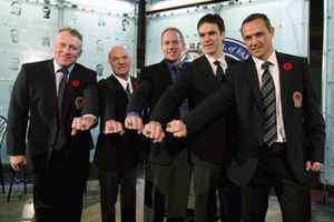 Hockey Hall of Fame inductees (left to right) Brett Hull, Lou Lamoriello, Brian Leetch, Luc Robitaille and Steve Yzerman show off their rings after being presented with them in a ceremony at the Hockey Hall of Fame in Toronto on Monday.