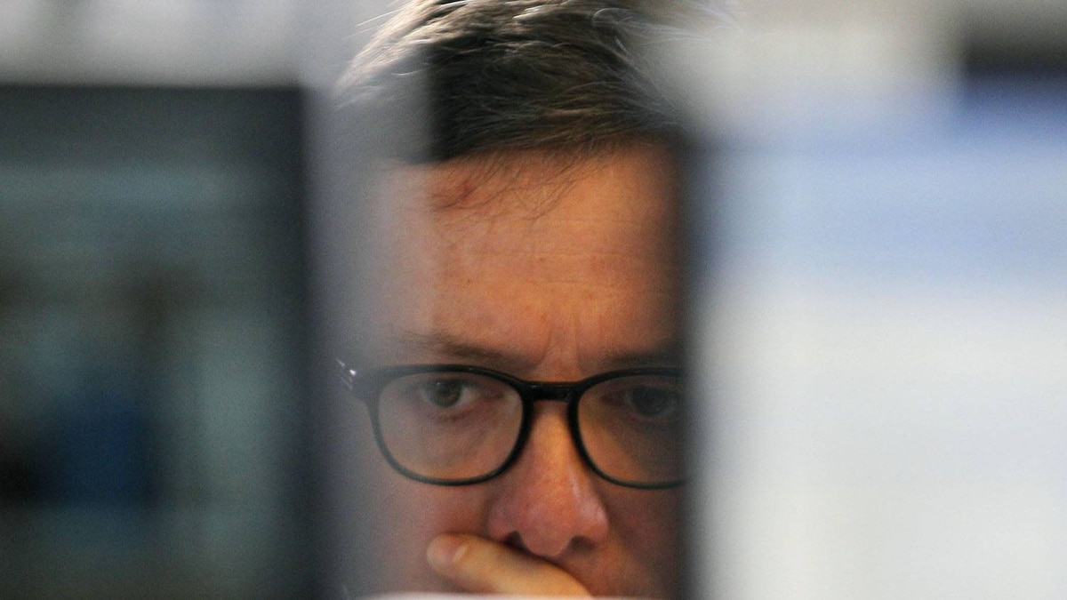 A stock trader is having a difficult day in Paris on Dec. 12, 2011.