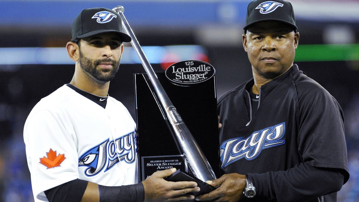 Toronto Blue Jays' Jose Bautista is presented with the Silver Slugger Award by Blue Jays hitting coach Dwayne Murphy (R) before their MLB American League baseball game against the Minnesota Twins in Toronto April 1, 2011. REUTERS/ Mike Cassese
