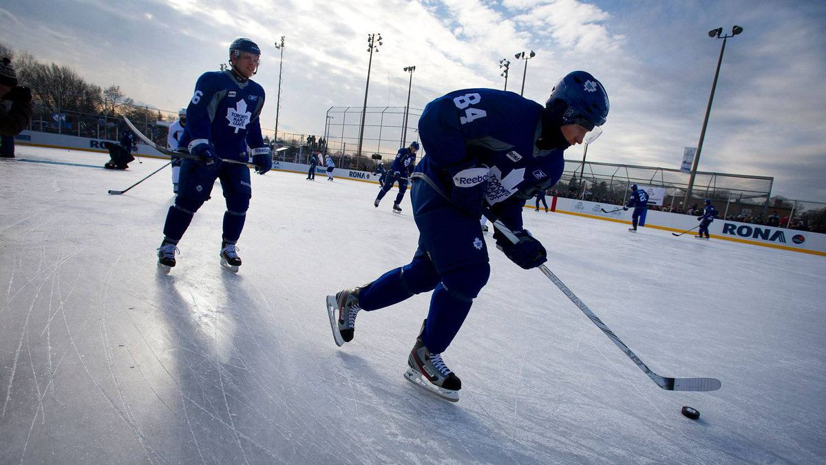 Leafs forwards Joey Crabb, left, and Mikhail Grabovski warm up at Sunnydale Acres Rink in Toronto, Ont., on Wednesday. The Leafs held the outdoor practice in celebration of the refurbishment of the rink by MLSE, Rona and the City of Toronto.