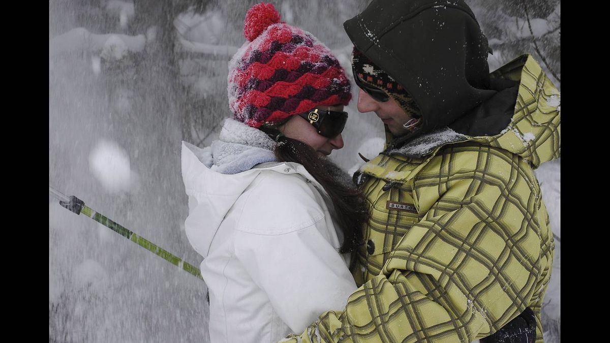 Barbara Baker photo: Relationships - Feb 2011 - My son and his girlfriend try to sneak in a kiss at Bragg Creek. Then the snow falls off a tree and my camera is handy and oh well ...