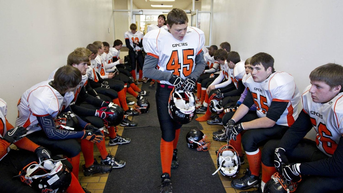 Warriors football players prepare for their game their game against the Sexsmith Sabres on Oct. 29, 2011.