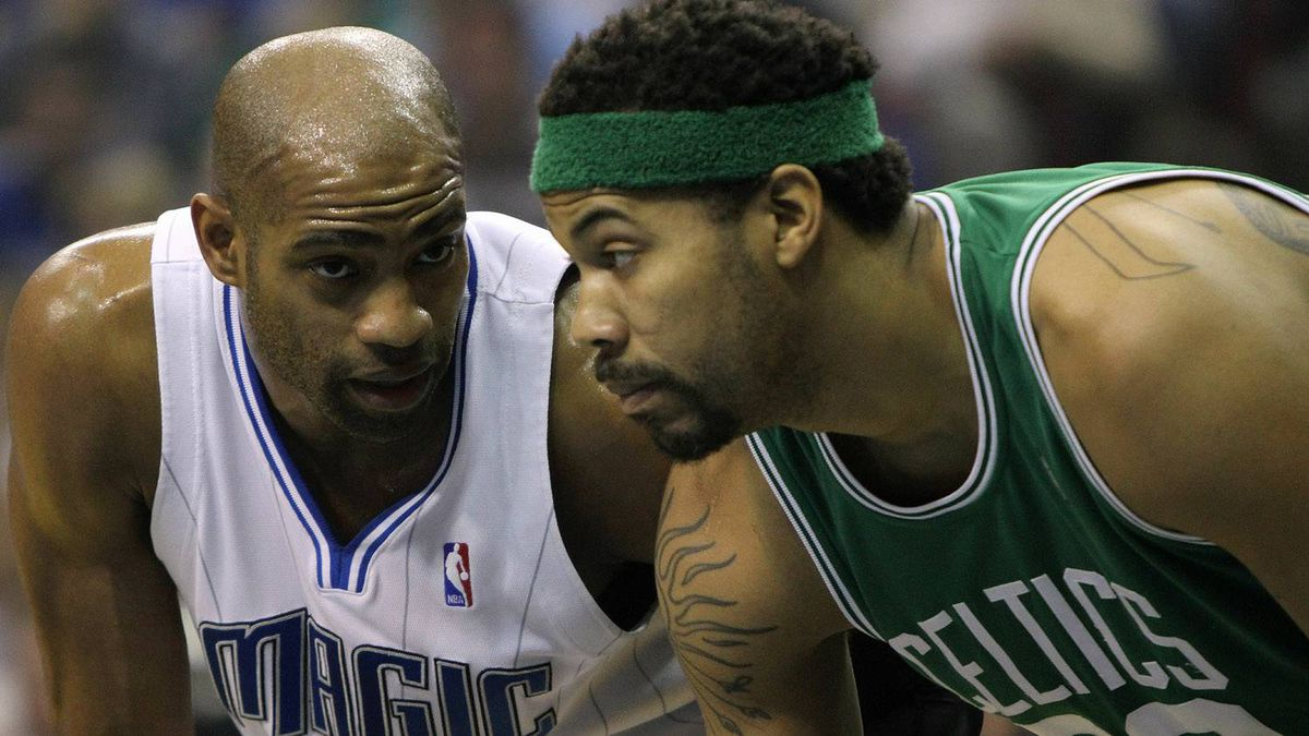 Vince Carter #15 of the Orlando Magic lines up next to Rasheed Wallace #30 of the Boston Celtics as they wait for a free throw attempt in Game One of the Eastern Conference Finals during the 2010 NBA Playoffs at Amway Arena on May 16, 2010 in Orlando, Florida. NOTE TO USER: User expressly acknowledges and agrees that, by downloading and/or using this Photograph, user is consenting to the terms and conditions of the Getty Images License Agreement. (Photo by Doug Benc/Getty Images)