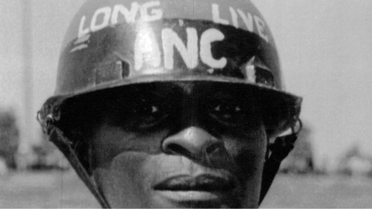 "An African National Congress supporter wearing a helmet with the slogan, ""Long Live ANC"", attends a peace tour of black townships by ANC leaders in the early 1990s. Political and tribal fighting has claimed more than 500 lives since August 12, 1990."