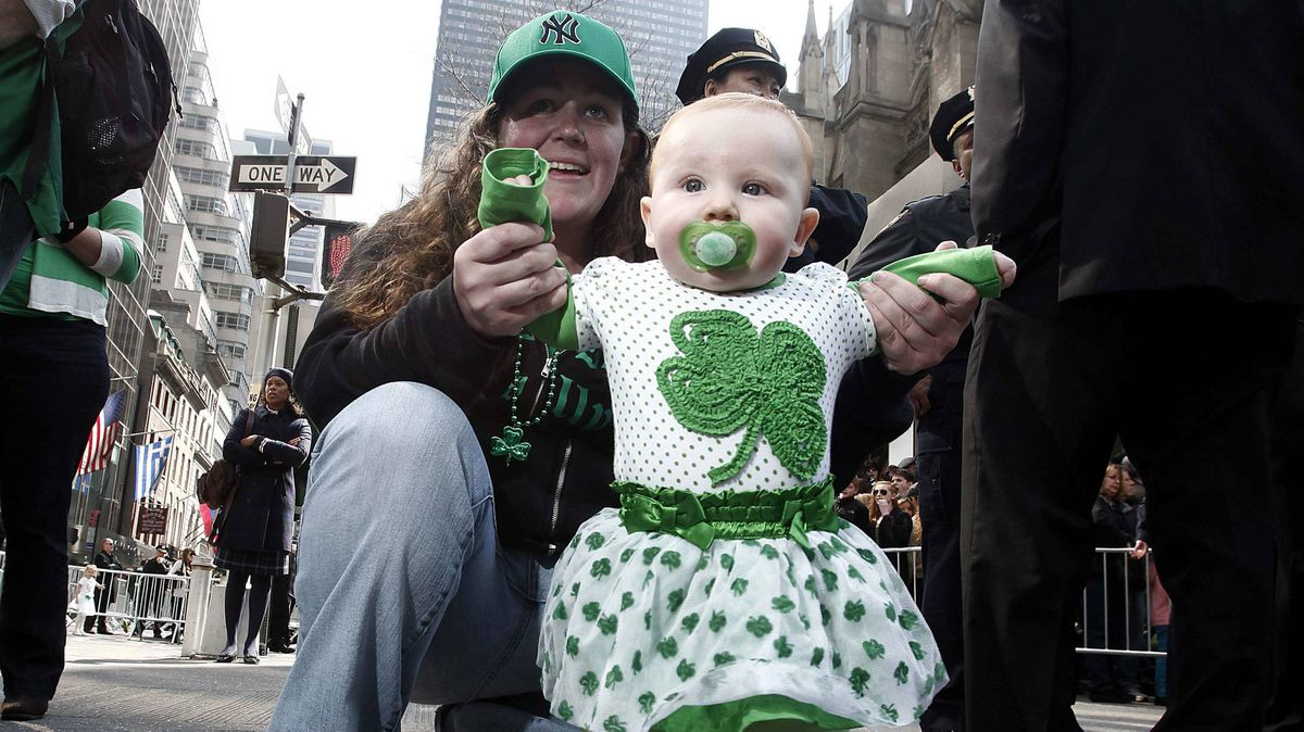 Madison Grace, seven months old, gets a hand from her mother to watch the St. Patrick's Day parade in New York on Saturday.
