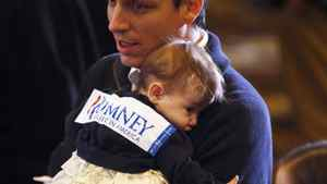 A young supporter starts to fade at Republican presidential candidate Mitt Romney's Super Tuesday primary election night rally in Boston on March 6, 2012.