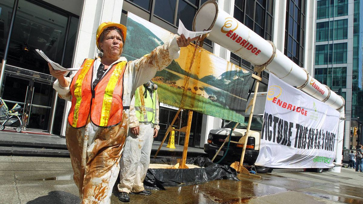 Greenpeace activists protest against the proposed Northern Gateway pipeline outside Enbridge's office in Vancouver on July 28, 2010