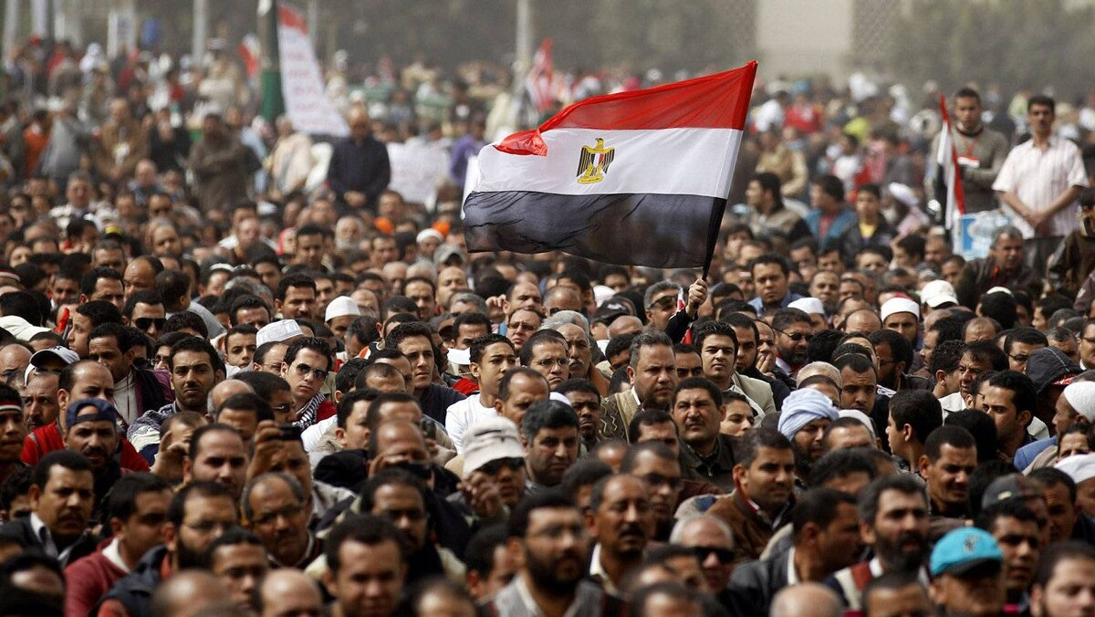 A man holds an Egyptian flag during a rally at Tahrir Square, in Cairo Feb. 25, 2011.