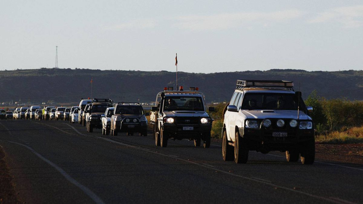 Vehicles transporting workers leave the Rio Tinto Parker Point iron ore facility in Dampier in the Pilbara region of Western Australia in this April 18, 2011 file photo. Australia will allow mining companies to use foreign workers to help address chronic labour shortages.