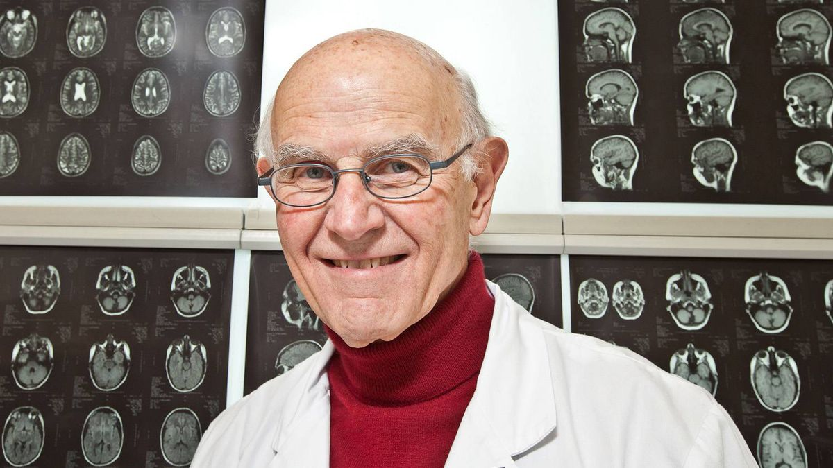 Dr. Charles Tator is seen with MRI brain scans at Toronto Western Hospital on February 6, 2011.