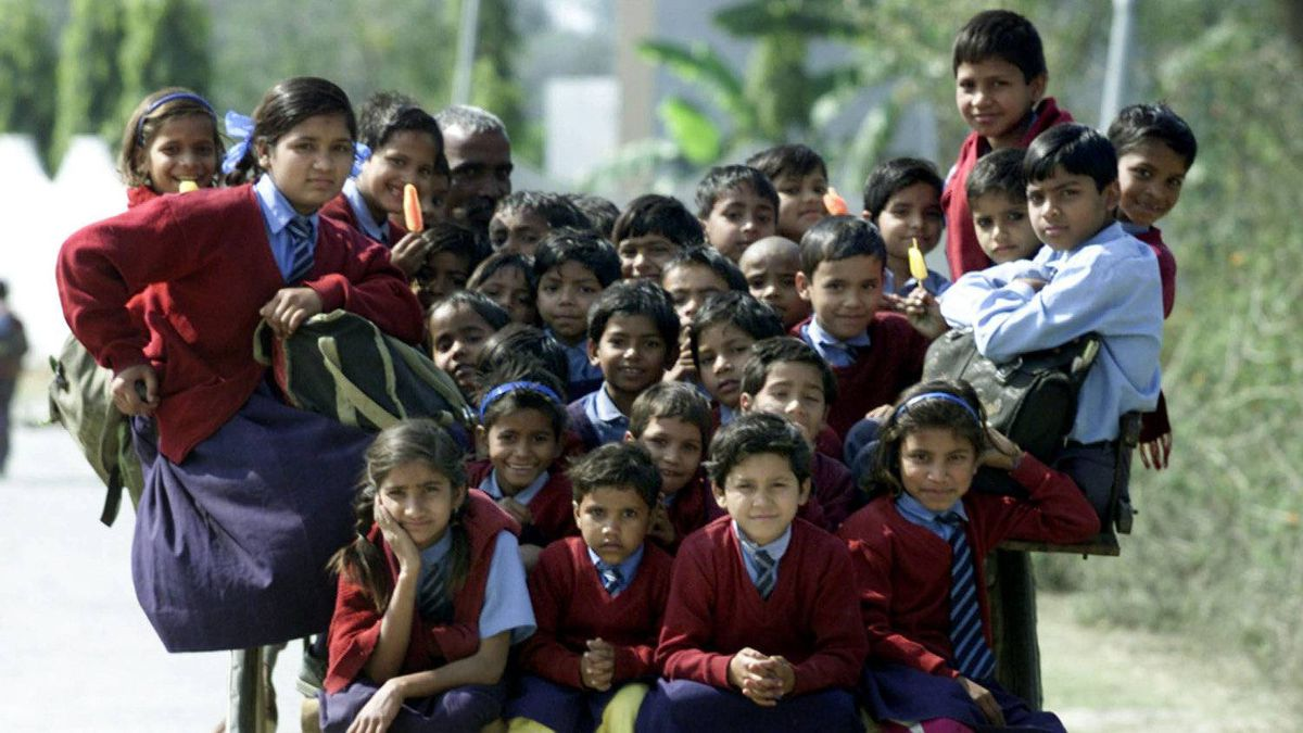 "More than thirty-five Indian children sit at the horse cart while coming back from school at the outskirts of New Delhi on February 26, 2001. The number of primary schools increased by 180 per cent from 210 thousand in 1951 to 590 thousand in 1996. Nevertheless, according to the report on ""Human Development in South Asia, 1998"", India has the largest illiterate population in the world - 424 million, which exceeds the total combined population of the North American continent and Japan."
