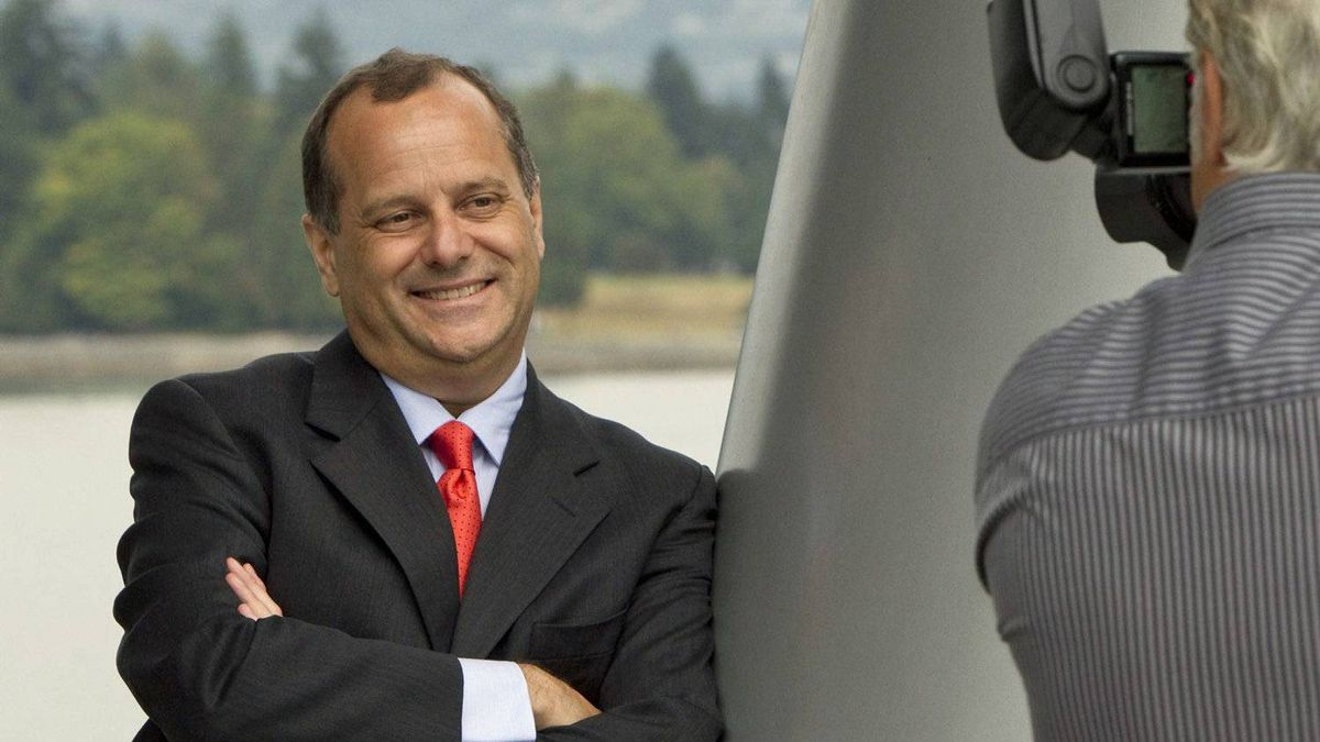 NDP leadership hopeful Brian Topp poses for a photographer after news conference in Vancouver on Sept. 13, 2011.