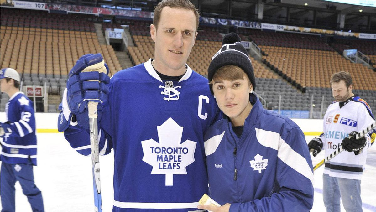 Justin Bieber poses for a photo with Maple Leafs captain Dion Phaneuf, Dec. 21, 2011. Bieber joined the Leafs to skate with the Children's Wish Foundation of Canada.