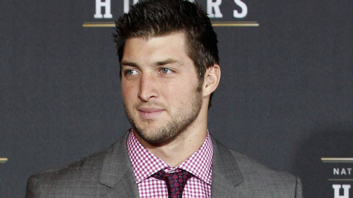 Denver Broncos quarterback Tim Tebow arrives for the Inaugural National Football League Honors at Super Bowl XLVI in Indianapolis, Indiana, February 4, 2012. REUTERS/Mike Segar