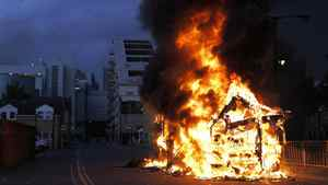 A bus is set on fire as rioters gathered in Croydon, south London, Monday, Aug. 8, 2011. Violence and looting spread across some of London's most impoverished neighborhoods on Monday, with youths setting fire to shops and vehicles, during a third day of rioting in the city that will host next summer's Olympic Games.