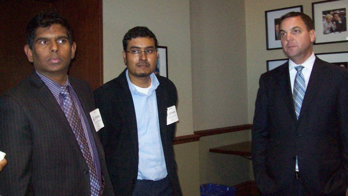 Rajkumar Subramaniam (far left), is an elected member of the National Council of Canadian Tamils. The man in the centre is unidentified. At right is Tim Hudak, Ontario Progressive Conservative party leader. The picture was obtained by The Globe and Mail from a source.