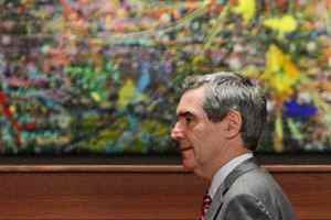 Liberal Leader Michael Ignatieff walks past a painting as he arrives for a news conference in Vancouver on Sept. 4, 2009.