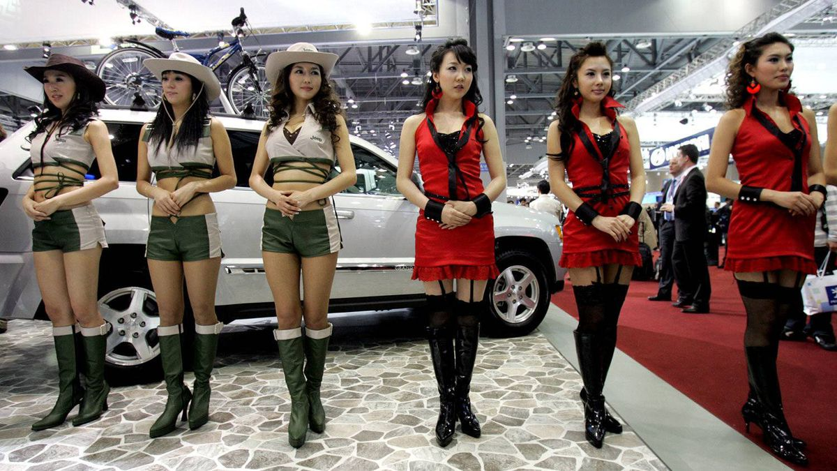 South Korean models stand during a press day of the Seoul Motor Show in Goyang, west of Seoul, South Korea in 2007.