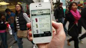 The distribution of third-party applications on iPhones and phones running on Google's Android system has helped create a surge in the popularity of those devices in recent years. However, recent reports suggest that iPhone and Android applications can access and upload a user's private photo collection, as well as the list of contacts. Associated Press reporter demonstrates an app for shopping on her smartphone, in San Francisco. If you're trying to save cash and time this holiday season, a slew of smartphone apps can help.(AP Photo/Jeff Chiu)