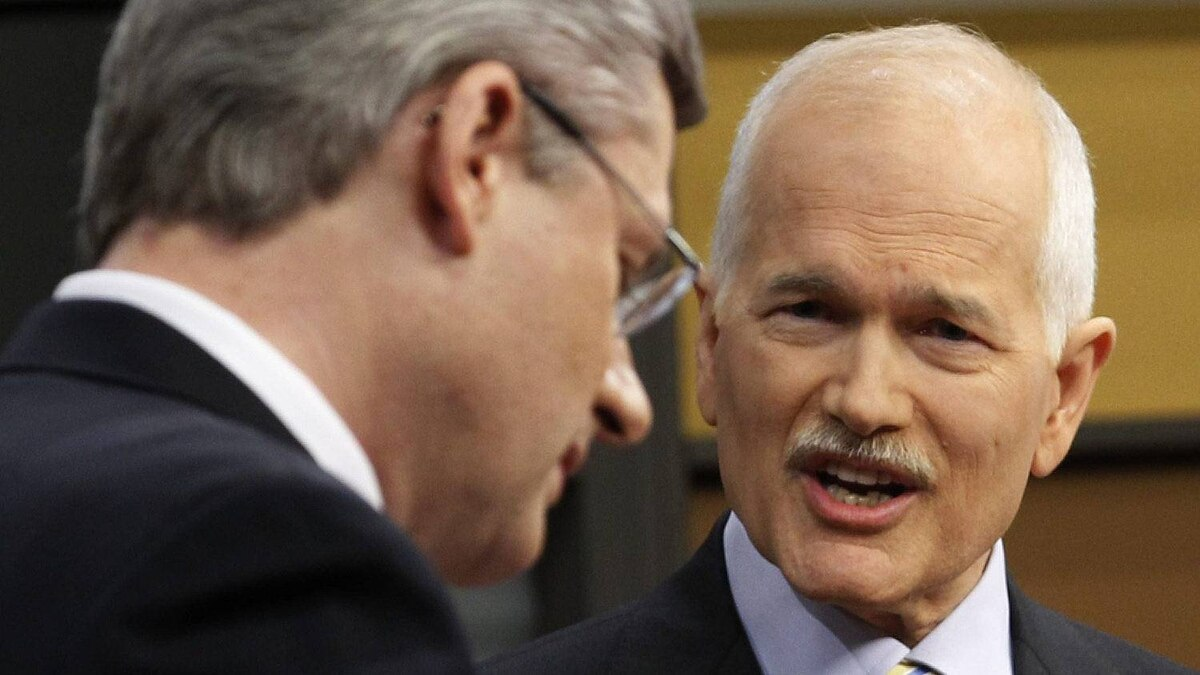 New Democratic Party leader Jack Layton, right, looks towards Prime Minister Stephen Harper as he answers a question during the English language federal election debate in Ottawa Ont., on Tuesday, April 12, 2011.