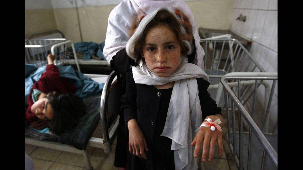 A school girl is seen at a hospital after she was poisoned at Qazaaq primary school in Kapisa province, north of Kabulin, May 12, 2009.