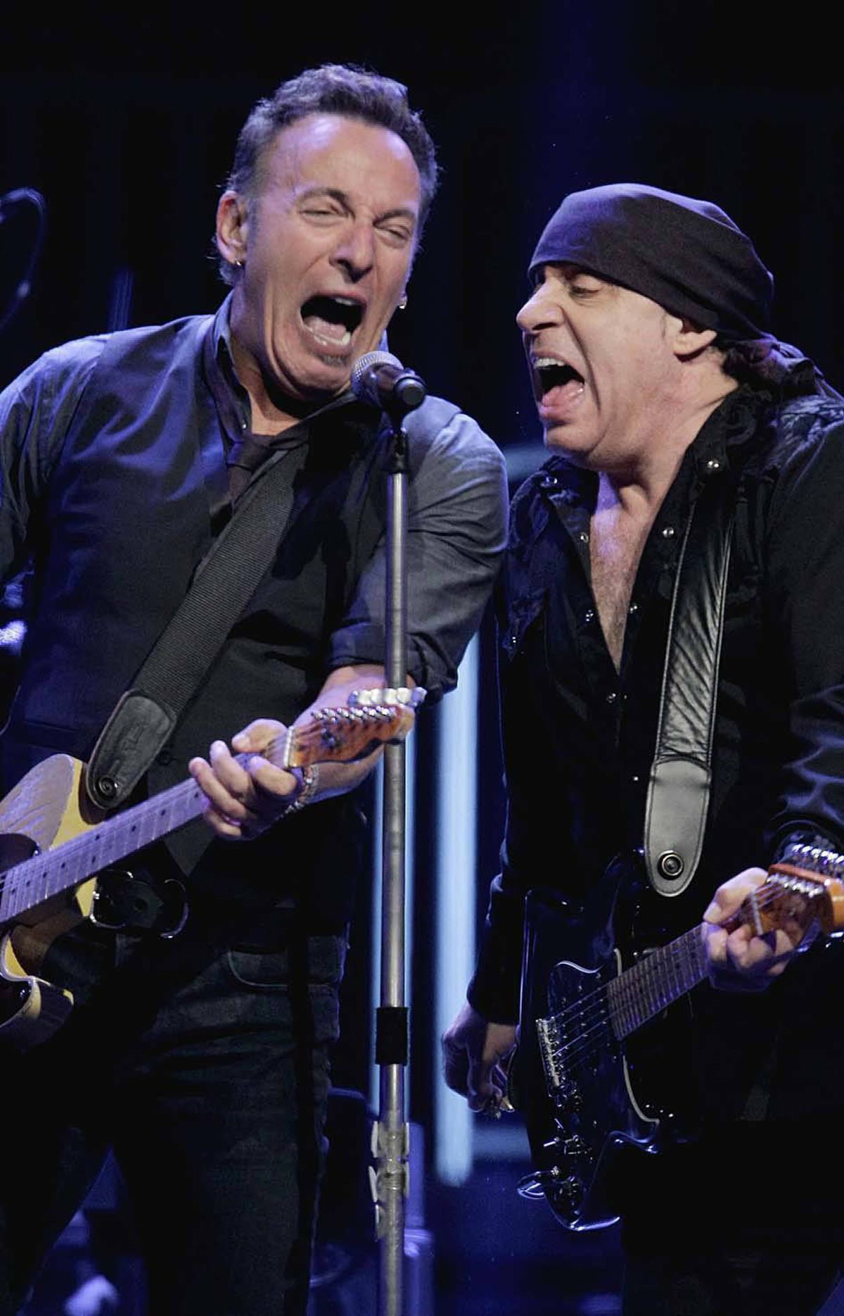 "And now a musical interlude: Bruce Springsteen, left, and Steven Van Zandt continue a 30-year tradition of yelling into the microhone together during Springsteen's ""Wrecking Ball"" concert tour premiere in Atlanta last week."