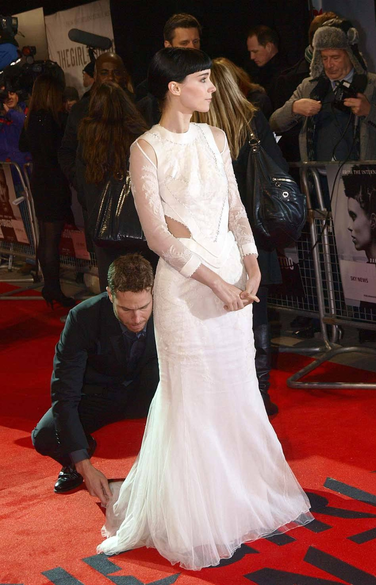 """Actress Rooney Mara prepares to throw a completely spontaneous look over the shoulder of her perfectly flowing gown at the world premiere of """"The Girl with the Dragon Tattoo"""" in London on Monday"""