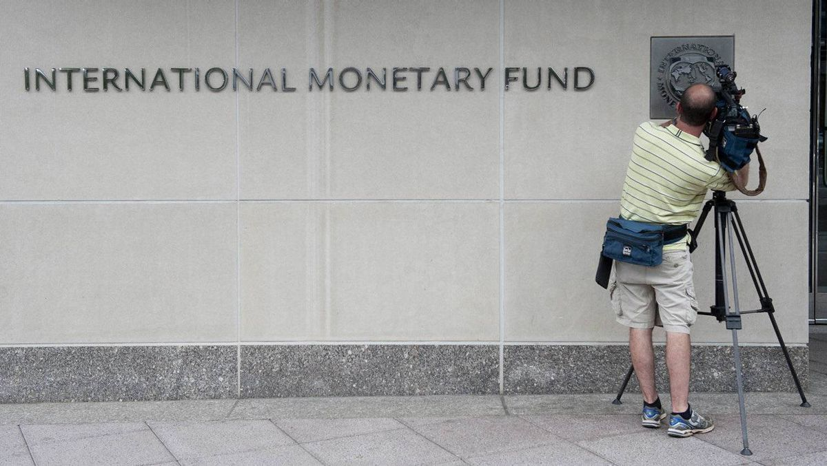 A televison camerman films the logo of the International Monetary Fund (IMF) at the organization's headquarters in Washington, DC, May 16, 2011.