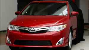 The 2012 Toyota Camry is unveiled during a news conference in Dearborn, Mich., Tuesday, Aug. 23, 2011.